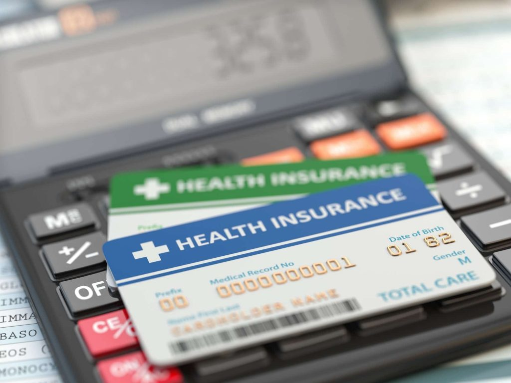 medical-insurance-cards-on-the-calculator-health-care-costs-con.jpg